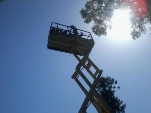 Filming atop a scissor lift.